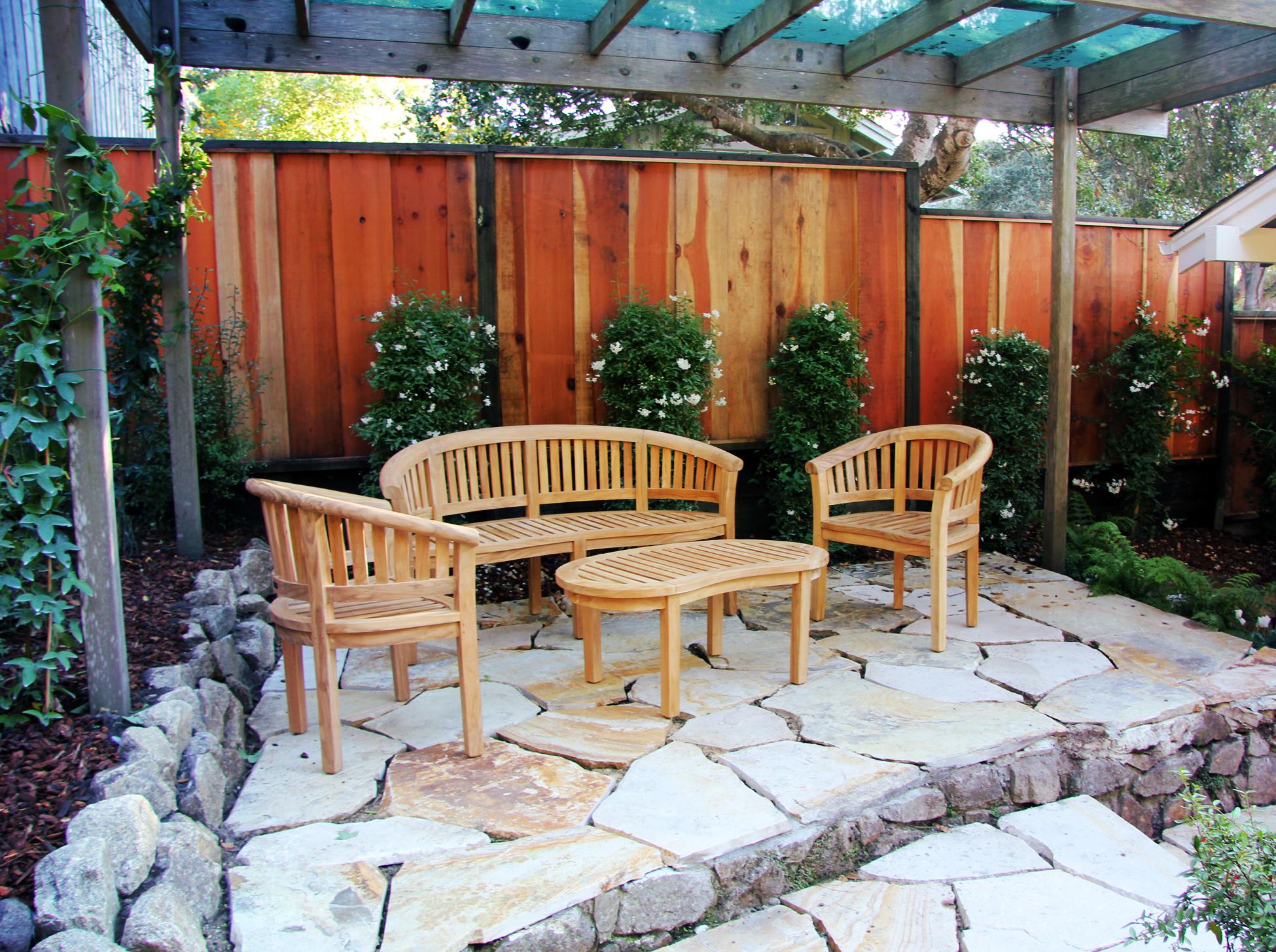 backyard sitting area under pergola